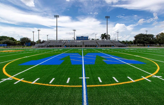 Phase one of the Wellington High School Sports Complex is complete with new artificial turf installed on the football field. [ALLEN EYESTONE/palmbeachpost.com]