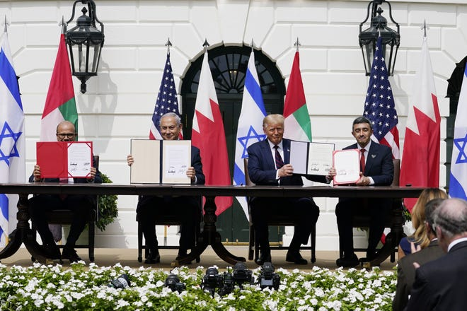 President Donald Trump, center, with from left, Bahrain Foreign Minister Khalid bin Ahmed Al Khalifa, Israeli Prime Minister Benjamin Netanyahu, Trump, and United Arab Emirates Foreign Minister Abdullah bin Zayed al-Nahyan, during the Abraham Accords signing ceremony on the South Lawn of the White House, Tuesday, Sept. 15, 2020, in Washington. (AP Photo/Alex Brandon)
