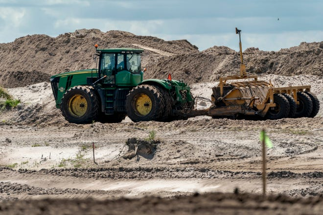 A Canadian business executive paid $155 million for 156 acres of land west of Boynton Beach, Florida. He has been building a lake without permits since February. (GREG LOVETT/The Palm Beach Post)