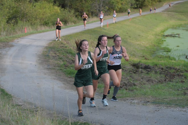 Members of the Woodward-Granger girls cross country team compete on Monday, Sept. 14 at the Ballard Golf and Country Club.