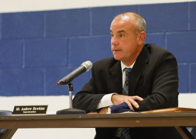 Rootstown superintendent Andrew Hawkins speaks to members of the community in attendance of Monday night's board of education meeting at Rootstown High School.