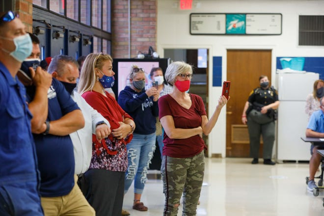 The Rootstown High School cafeteria was standing room only for Monday night's board of education meeting.