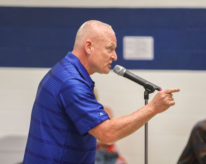 A community member addresses the Rootstown superintendent and board of education at Monday night's meeting at Rootstown High School.