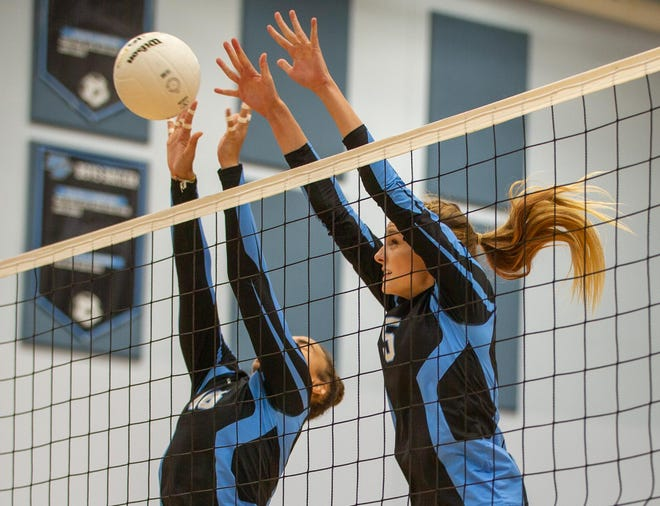 Ponte Vedra's Amy Burkhardt (5) and Zeta Washington (16) leap to score during a Sept. 14 match against Middleburg. The Sharks, state volleyball champions, drew the No. 4 seed in District 4-5A.