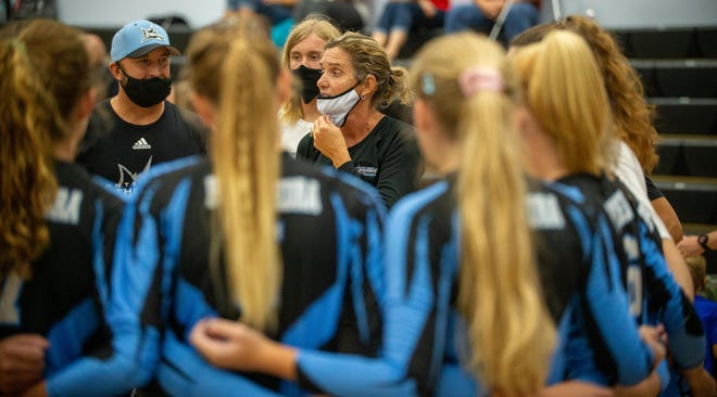 Ponte Vedra volleyball coach Robin Mignerey, center, speaks with the Sharks during a pregame huddle. Mignerey was selected Tuesday as the Florida Dairy Farmers Coach of the Year.