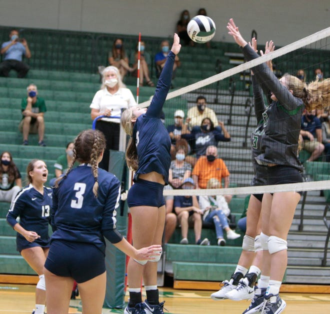 Parrish Community High and Lakewood Ranch High battle at the net for a point in the season opener for both teams Monday evening in Lakewood Ranch. It was the first varsity match for the Bulls.