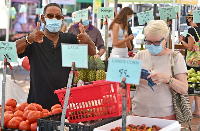 Mike Dancil of Lakewood Ranch gives two thumbs up at The Sarasota Farmers Market, which reopened on Aug. 1, 2020, after being shut down for five months to prevent the spread of the coronavirus. The Bradenton Farmers' Market, which was on an extended summer hiatus because of COVID-19 concerns, returns Oct. 3.