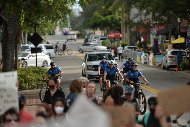 Protesters march down Main Street in downtown Sarasota on June 2 in a show of support for racial justice. Candidates for the Sarasota City Commission say that significant police reform is not needed in the city.