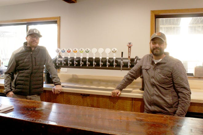 Lance Banks, left, and owner Sparrow Tang are seen standing to their updated tap system. Etna Brewing Company will offer a wide variety of brews, including local favorites such as the blackberry blonde, and classic root beer.