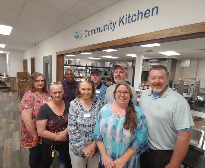 The staff at Religious Community Services is ready to begin the inside reopening of all but the Community Kitchen with a Thursday virtual ribbon cutting. Above is RCS board President David Kick, right, along with staff members Rosa Davis, Jeanette Pawelczyk, Judy Myrick, Mike Wilson, Chad Morse and Tony Laboy.