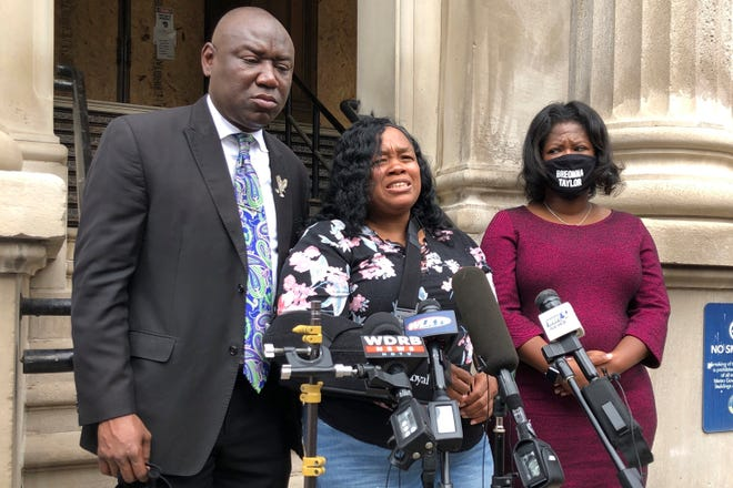Tamika Palmer, mother of Breonna Taylor, addresses the media in Louisville, Ky., on Aug. 13. The city of Louisville will pay several million dollars to Palmer and install police reforms as part of a settlement of a lawsuit from Taylor's family, The Associated Press has learned. [AP file photo by Dylan Lovan]