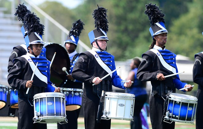 Childersburg band members perform during their set at the 2019 Mid-South Marching Band Festival at Titan Stadium in Gadsden. The 2020 event has been canceled because of the COVID-19 pandemic.