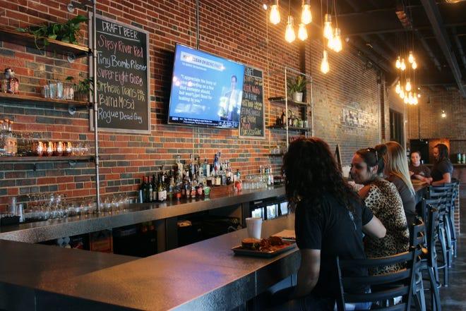 Guests have lunch at the bar at The Rail Public House in downtown Gadsden in a file photo from 2019.