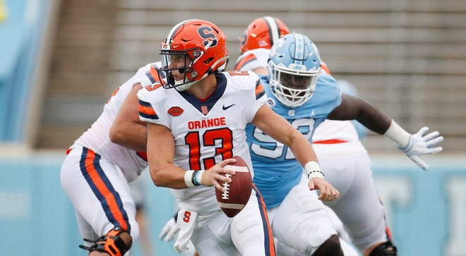 North Carolina defensive lineman Jahlil Taylor breaks through and pressures Syracuse quarterback Tommy DeVito during Saturday's game in Chapel Hill.