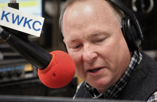 Matt Smith checks his notes while talking about the weather during his final ag report Friday. He did his last one at the KWKC studio downtown, instead of from Tuscola, where he lives. Sept. 11 2020