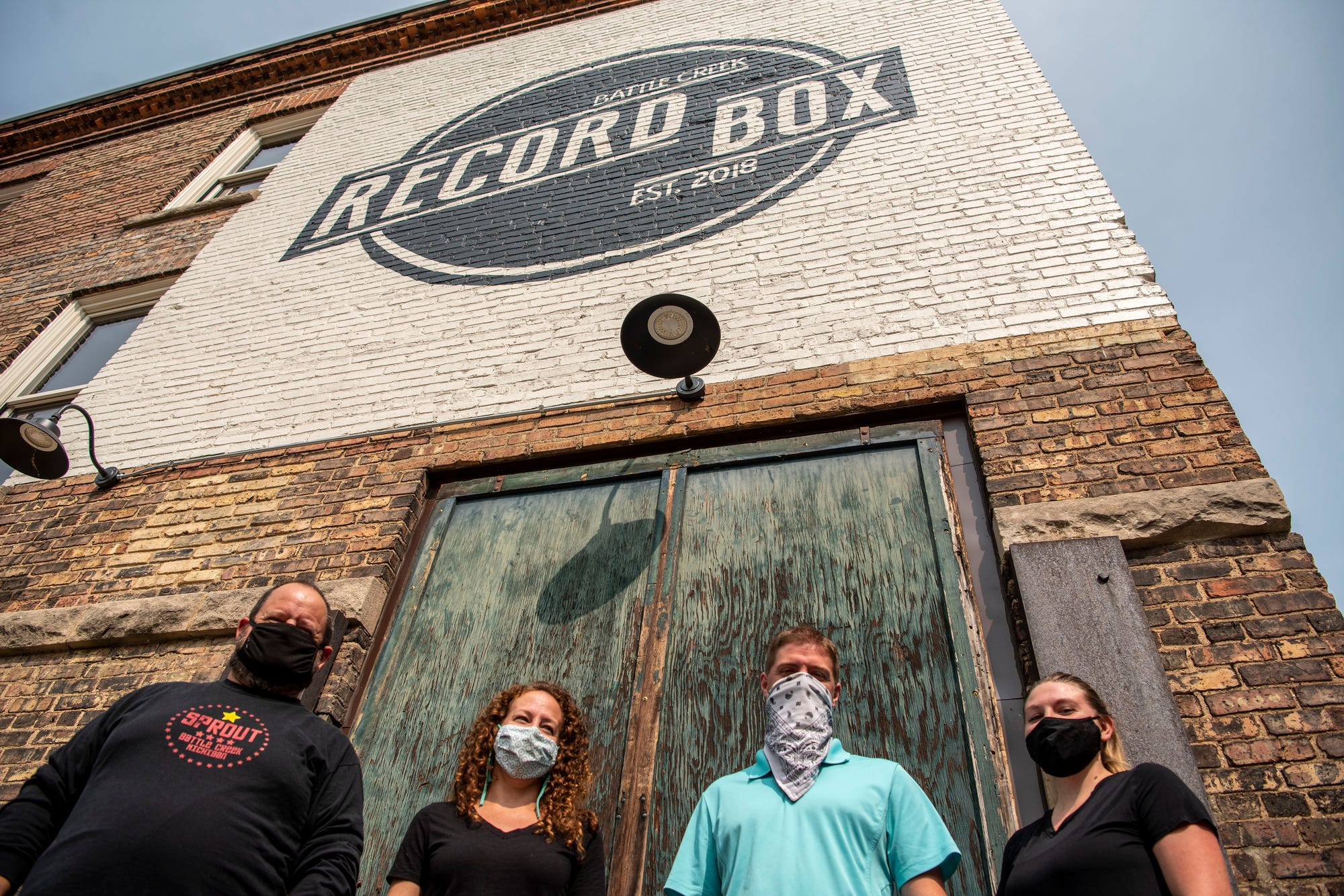 Jeremy Andrews, Lydia Marucco, Cody Newman and Caitlynn Newman stand for a portrait together on Tuesday, Sept. 15, 2020 outside The Record Box in Battle Creek, Mich. Sprout is partnering with Restore 269 to open a downtown market and deli in Battle Creek.