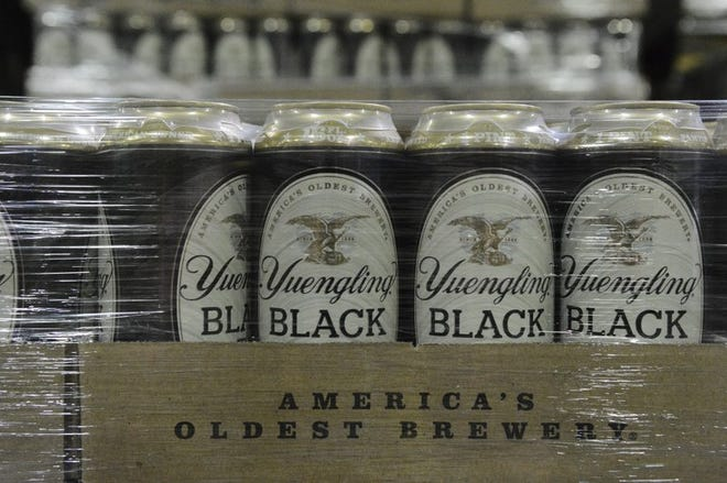 Yuengling Black and Tall cans are stacked in a warehouse of one of the company's Pennsylvania breweries. The oldest brewer in the country will soon expand distribution to the West Coast.
