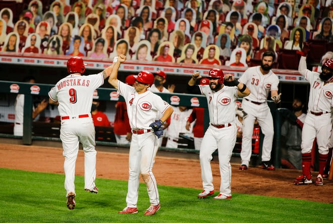 Cincinnati Reds second baseman Mike Moustakas (9) celebrates his home run against the Pittsburgh Pirates in the fifth inning of the night game on Monday, Sept. 14, 2020, at Great American Ball Park in Cincinnati. Reds won 9-4.