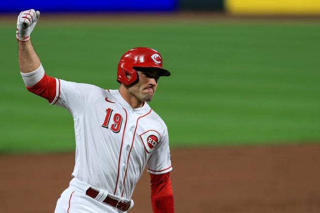 Cincinnati Reds' Joey Votto reacts as he runs the bases after hitting a solo home run in the third inning during a baseball game against the Pittsburgh Pirates in Cincinnati, Monday, Sept. 14, 2020.