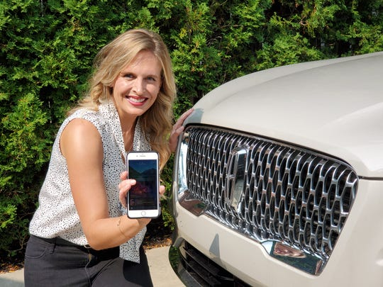 Kristen Grimske, a marketing business consultant frommetro Detroit, ownsa 2020 Corsair and her husband drives a 2017 MKZ. She said the Calm app is especially helpful during the workday. She is shown here on September 15, 2020 with her phone that links her to the new app.