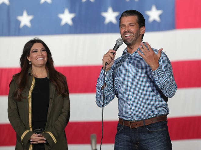 Kimberly Guilfoyle listens as Donald Trump Jr. speaks at a rally in Harrison Township Monday, Sept. 14, 2020. About a couple thousand supporters were there along with Kid Rock, who sang after Trump spoke.