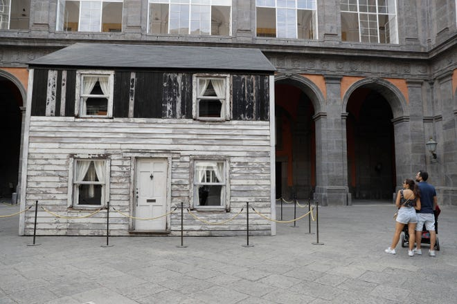 The house of U.S. civil rights campaigner Rosa Parks, rebuilt by artist Ryan Mendoza, is on display in the courtyard of an 18th century Royal Palace, in Naples, Italy, Tuesday, Sept. 15, 2020. It's the latest stop for the house in a years-long saga that began when Parks' niece saved the tiny two-story home from demolition in Detroit after the 2008 financial crisis.