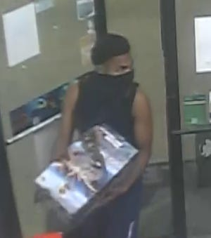 Police are searching for this man after someone set off fireworks inside a gas station in Detroit.