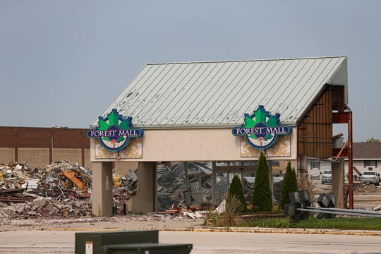 Work continues on the demolition of the former Forest Mall  on West Johnson Street.