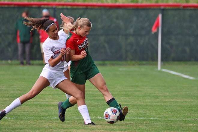 Port Clinton's Jade Mitchell and Oak Harbor's Amelia Mizelle fight for control.