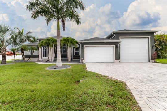 Andrew and Mary Courtade's home in Cape Coral has a 17,000 square foot lot as well as a huge RV garage.