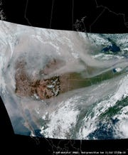 A satellite image showing smoke from wildfires on the West Coast spreading across the country by the jet stream. Officials say the high level smoke is the cause of the hazy, cloudless skies and more colorful sunsets in Indiana.