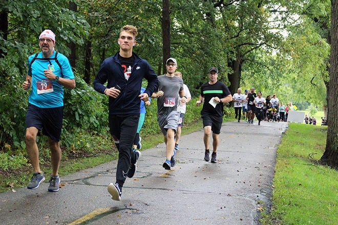 Runners participate in the 2019 Bull Run on Sept. 28, 2019. The race raises funds for ALS of Michigan.