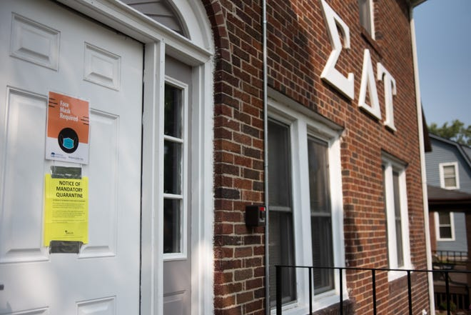 A sign on the Sigma Delta Tau sorority house on Charles Street in East Lansing seen Tuesday, Sept. 15, 2020 warns residents there to self-quarantine.