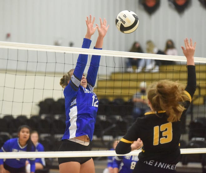 Cotter's Tylar Coots blocks a hit by Salem's Grace Benedict during the Lady Warriors' victory Monday night.