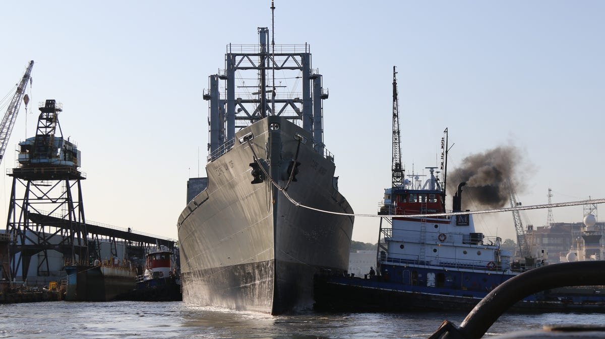 Tugboats pull the Cape Avinof, a cargo ship, from the Brooklyn Navy Yard into the East River.