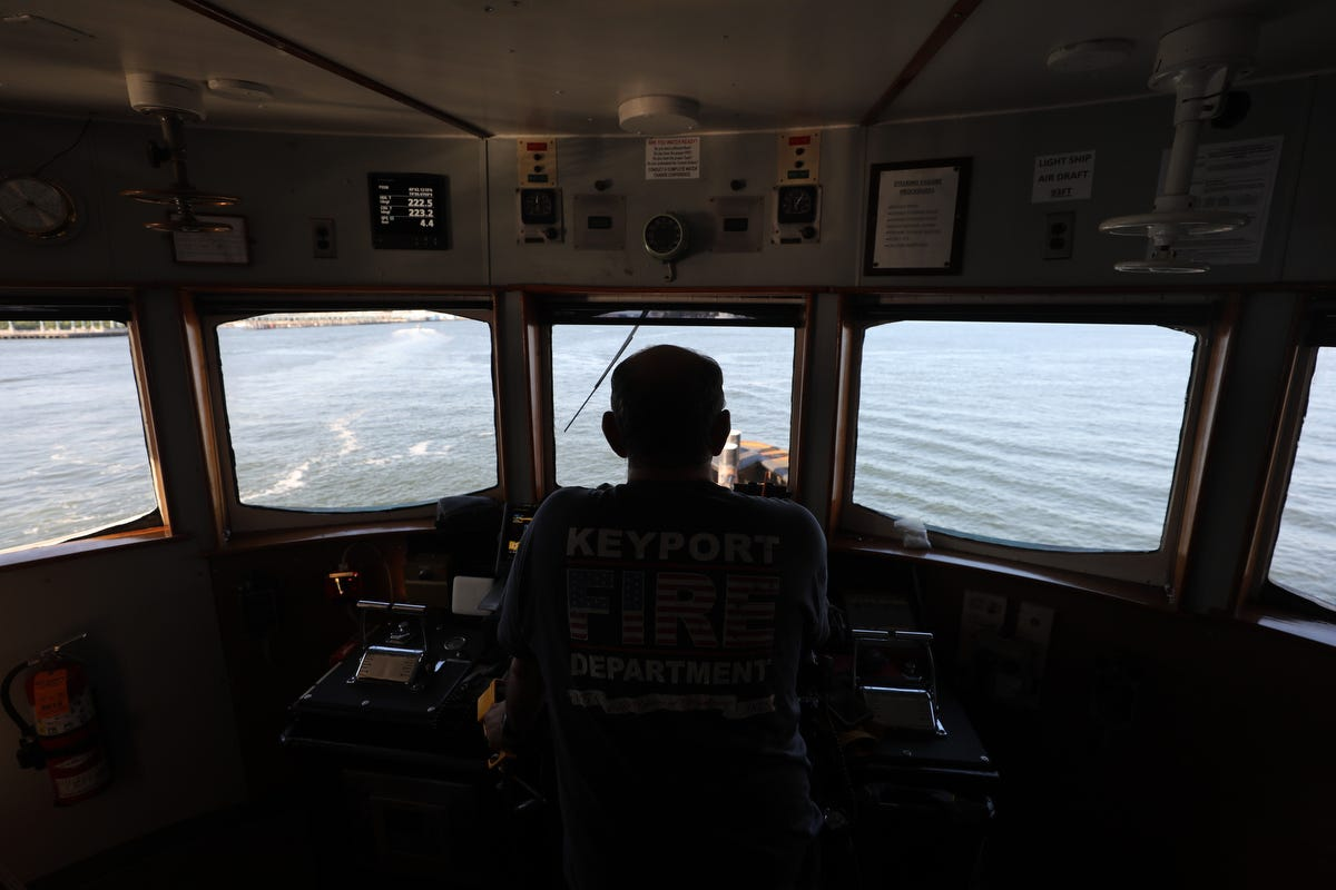 Mike Vinik, owner and operator of Vinik Marine, at the wheel of one of his tugboats.