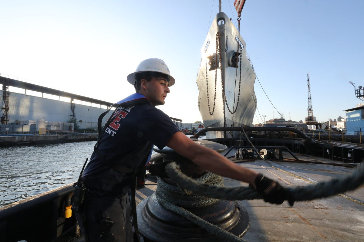 A deckhand secures a line from a cargo ship that Vinik Marine moved from the Brooklyn Navy Yard to Norfolk, Virgina.