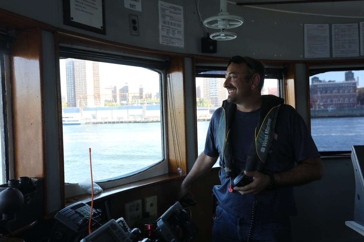 Mike Vinik stands in the pilot house of one of his tugs in New York Harbor.