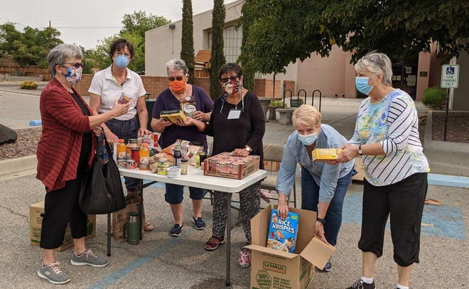 "The Las Cruces chapter of American Association of University Women held a ""drive-thru"" meeting to collect donations for the Aggie Food Bank and The Children's Reading Alliance Sept. 12. Left to right: Laura Bemis (President), Elaine Rude, Lynne Lord, RoseAnn Hernandez, Gloria Tibbetts and Donna Yargosz."