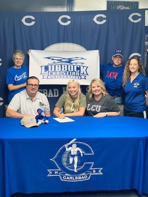 Carlsbad's Blair Bowen signs her letter of intent to attend Lubbock Christian University on Sept. 15, 2020. Surrounding Blair are her parents Bobby and Tammy Bowen, her grandparents Mike and Pat Veilleux and her cheer coach Cheri Young.