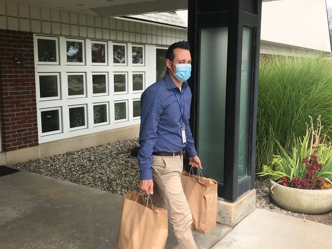 Chad Ozias leaves CARE House to deliver needed supplies to a family they serve. Groceries and food cards for stores were donated by supporters of CARE House and delivered by their corps of volunteers.