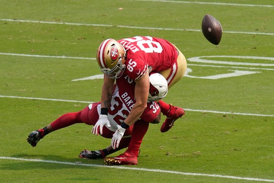 San Francisco 49ers tight end George Kittle (85) is hit by Arizona Cardinals strong safety Budda Baker (32) during the first half of an NFL football game in Santa Clara, Calif., Sunday, Sept. 13, 2020. (AP Photo/Tony Avelar)