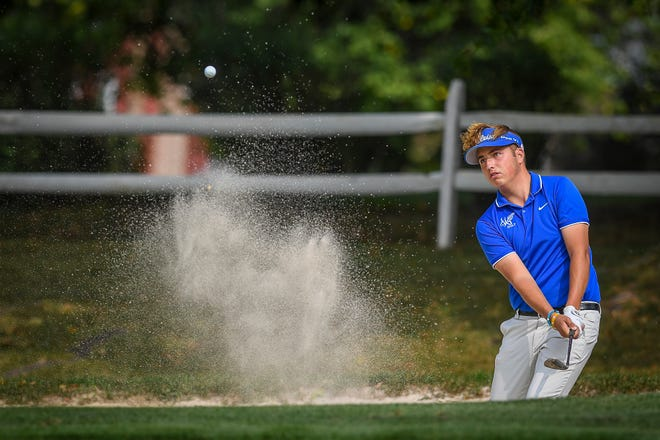 Spring Grove's Karl Frisk chips out of the bunker on hole nine of the York-Adams Division I golf match at South Hills Golf Club, Tuesday, September 15, 2020. 