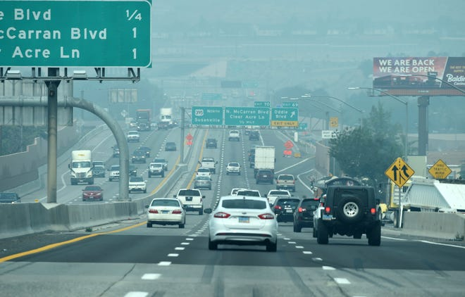 Smoke from the California wildfires fill the Reno sky as commuters move along the U.S. 395 on Tuesday Sept. 15, 2020