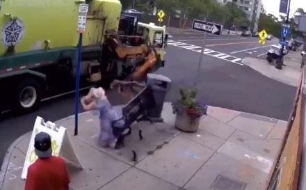 Woman thrown through air in garbage truck accident