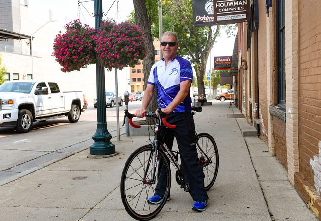 Dr. Mike Heisler, a Critical Care physician from Sioux Falls, poses for a portrait with his bicycle on Tuesday, September 15, in Sioux Falls.