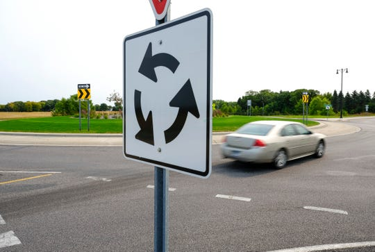 Traffic moves through the roundabout Heritage Drive, Fourth Avenue, Leander Avenue and Roberts Road Tuesday, Sept. 15, 2020, in Sartell.