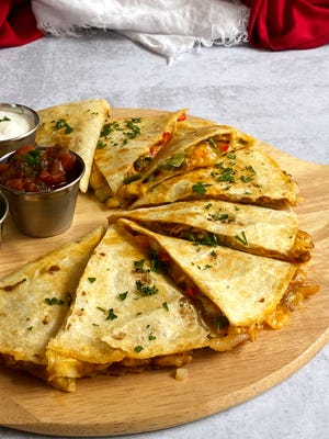 Chicken Fajita Quesadilla is tender on the inside and crispy on out the outside.