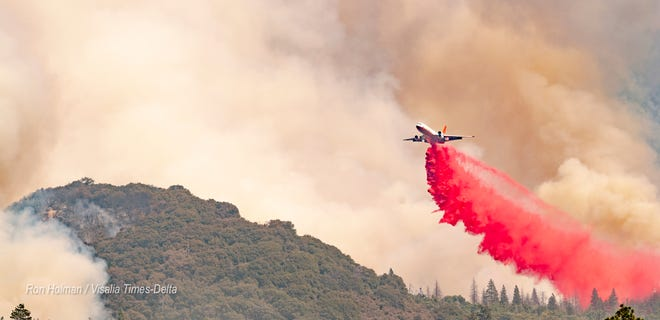 A tanker drops retardant as smoke from the SQF Complex Fire billows Monday, September 14, 2020 near Camp Nelson and areas along Highway 190 east of Springville. The fire has also lead to a partial closure of Sequoia National Park.