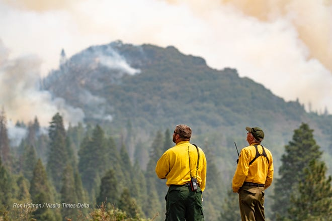 Multiple agencies coordinate Monday, September 14, 2020 to defend Camp Nelson and areas along Highway 190 east of Springville from the SQF Complex Fire. The fire has also lead to a partial closure of Sequoia National Park.